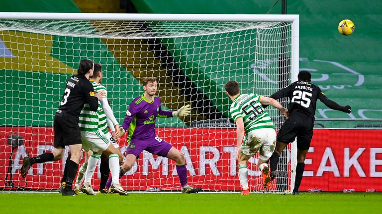 Efe Ambrose (right) missed a close-range header for Livingston against his former club in their Celtic Park stalemate