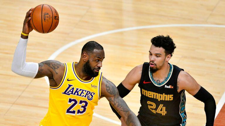 AP - Los Angeles Lakers forward LeBron James (23) handles the ball against Memphis Grizzlies guard Dillon Brooks (24)