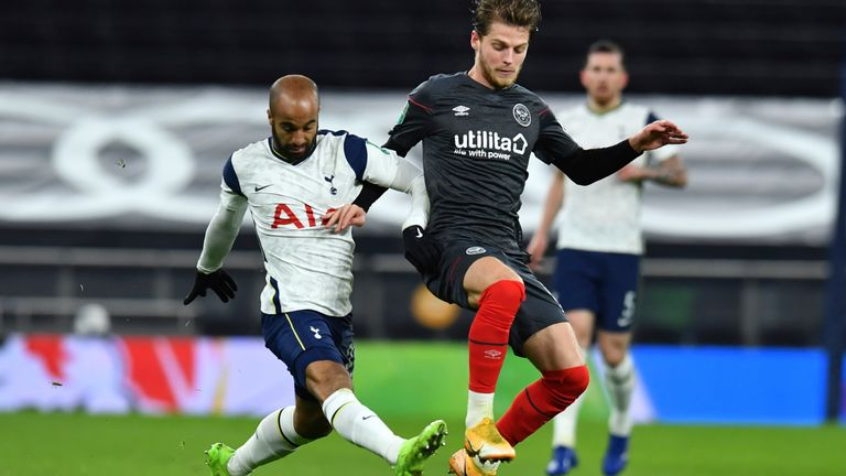 Lucas Moura and Brentford's Mathias Jensen fight for the ball on Tuesday