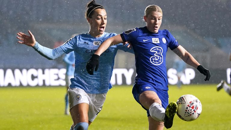 Manchester City's Lucy Bronze battles for the ball with Chelsea's Beth England during their League Cup quarter-final