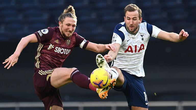 Luke Ayling and Harry Kane battle for the ball