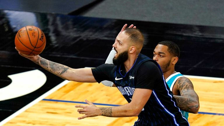 AP - Orlando Magic guard Evan Fournier (10) gets off a shot in front of Charlotte Hornets forward P.J. Washington during the first half