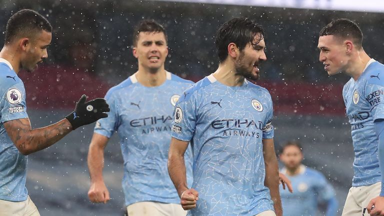 Ilkay Gundogan and his Man City team-mates celebrate against Aston Villa