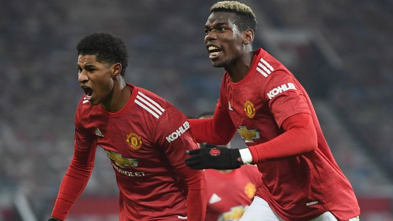 Manchester United's Marcus Rashford celebrates with Paul Pogba