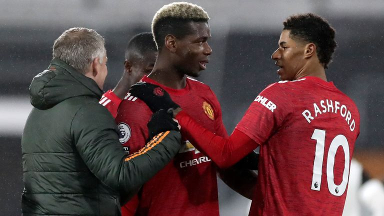 Ole Gunnar Solskjaer congratulates Paul Pogba at full-time at Fulham