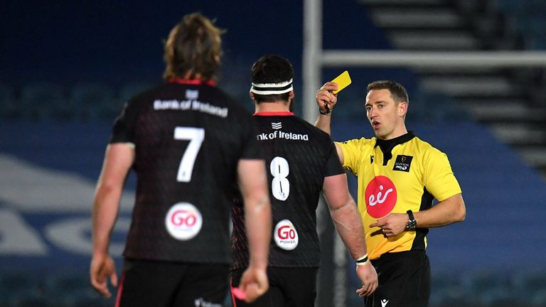 Referee Andrew Brace shows a yellow card to Marcell Coetzee