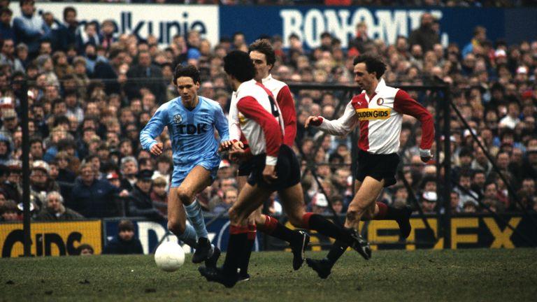 Ajax's Marco van Basten runs in defense of Feyenoord including Johan Cruyff in an Eredivisie match between the teams in 1984