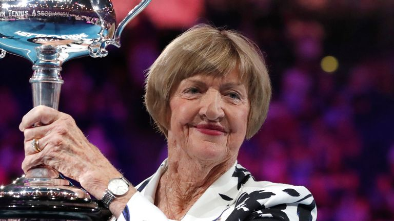 Margaret Court holds up the Australian Open trophy in 2020 fifty years on from winning four Grand Slams in the calendar year
