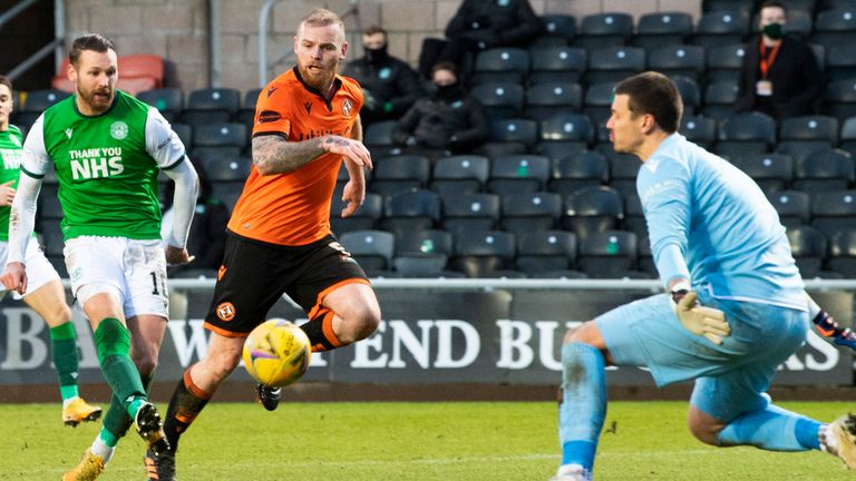 DUNDEE, SCOTLAND - JANUARY 30: Hibernian's Martin Boyle (L) makes it 2-0 during a Scottish Premiership match between Dundee United and Hibernian at Tannadice Park on January 30, 2021, in Dundee, Scotland. (Photo by Ross Parker / SNS Group)