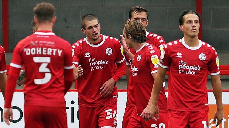 Max Watters (No 36) celebrates with his Crawley team-mates