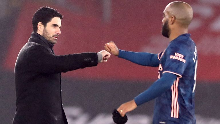 Mikel Arteta congratulates Alexandre Lacazette at St Mary's
