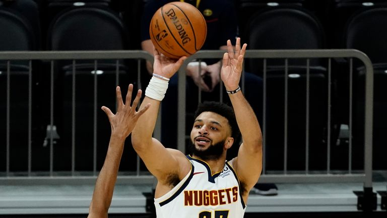 Denver Nuggets guard Jamal Murray shoots over Phoenix Suns forward Mikal Bridges (25) during the first half of an NBA basketball game Saturday, Jan. 23, 2021, in Phoenix.