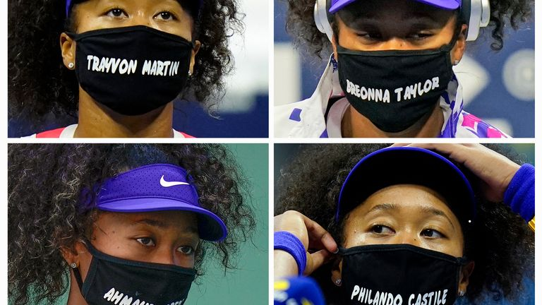 Naomi Osaka, of Japan, wears face masks bearing the names of Black victims of police violence and racial profiling during the U.S. Open tennis tournament in New York Osaka has been selected by The Associated Press as the Female Athlete of the Year.