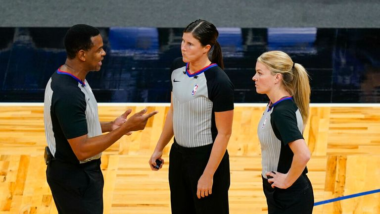 AP - Referees from left, Sean Wright, Natalie Sago and Jenna Schroeder have a discussion during a time out in the second half of an NBA basketball game between the Orlando Magic and the Charlotte Hornets,