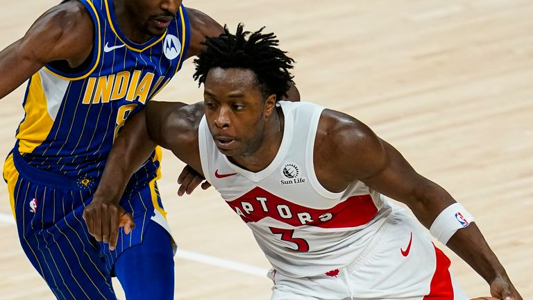 Toronto Raptors forward OG Anunoby (3) drives on Indiana Pacers guard Justin Holiday (8) during the second half of an NBA basketball game in Indianapolis, Sunday, Jan. 24, 2021.