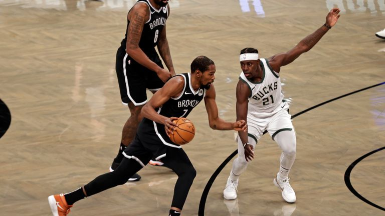 Brooklyn Nets forward Kevin Durant (7) in action during the first half of an NBA basketball game against the Milwaukee Bucks, Monday, Jan. 18, 2021, in New York. (AP Photo/Adam Hunger)