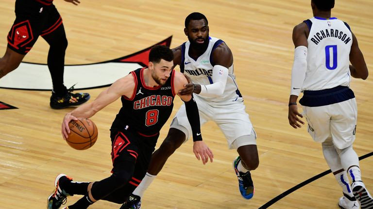 Chicago Bulls' Zach LaVine (8) drives against Dallas Mavericks' Tim Hardaway Jr. (11) during the first half of an NBA basketball game Sunday, Jan. 3, 2021, in Chicago. (AP Photo/Paul Beaty)