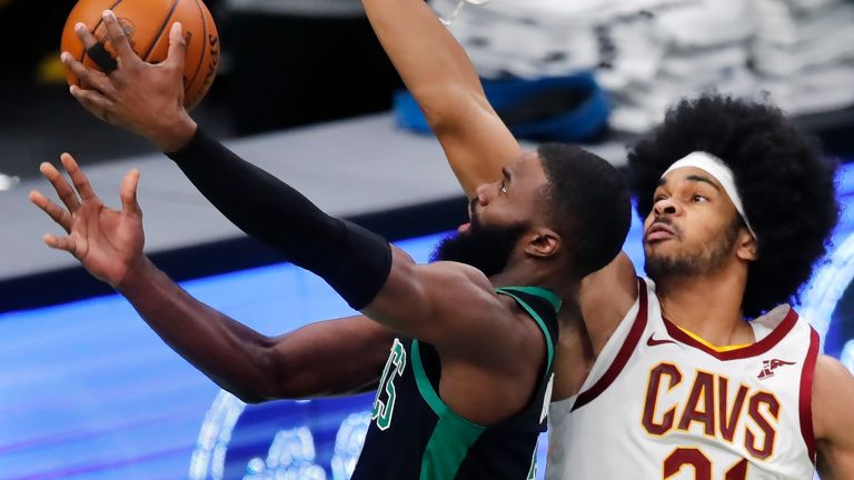 Boston Celtics' Jaylen Brown shoots against Cleveland Cavaliers' Jarrett Allen (31) during the first half of an NBA basketball game, Sunday, Jan. 24, 2021, in Boston.