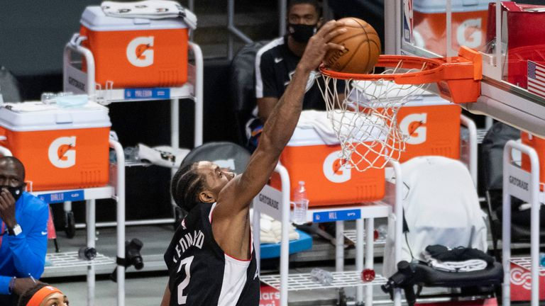 Los Angeles Clippers Forward Kawhi Leonard (2) dunks the ball during an NBA game between the Los Angeles Clippers and the Oklahoma City Thunder and the on January 24, 2021 at STAPLES Center in Los Angeles, CA.
