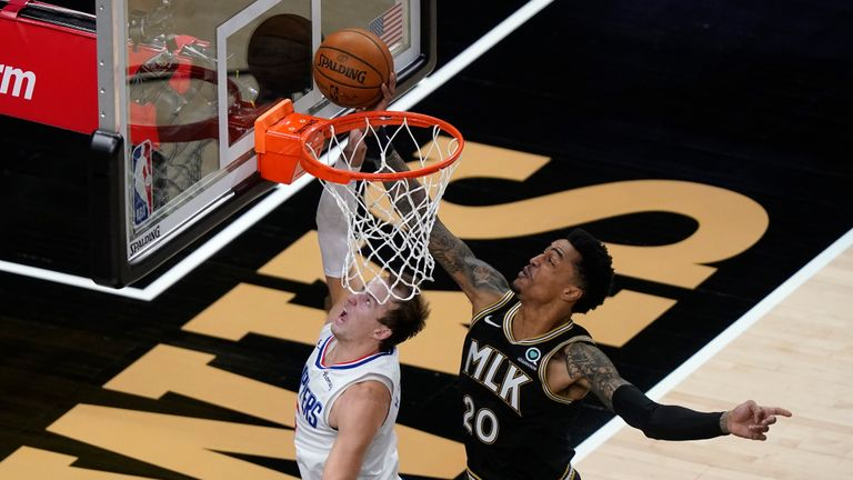 Los Angeles Clippers guard Luke Kennard (5) has his shot blocked by Atlanta Hawks forward John Collins (20) in the second half of an NBA basketball game Tuesday, Jan. 26, 2021, in Atlanta. (AP Photo/John Bazemore)