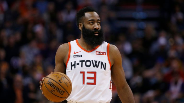 Houston Rockets guard James Harden dribbles the ball against the Phoenix Suns during the first half of an NBA basketball game Saturday, Dec. 21, 2019, in Phoenix. The Rockets defeated the Suns 139-125. (AP Photo/Ross D. Franklin)