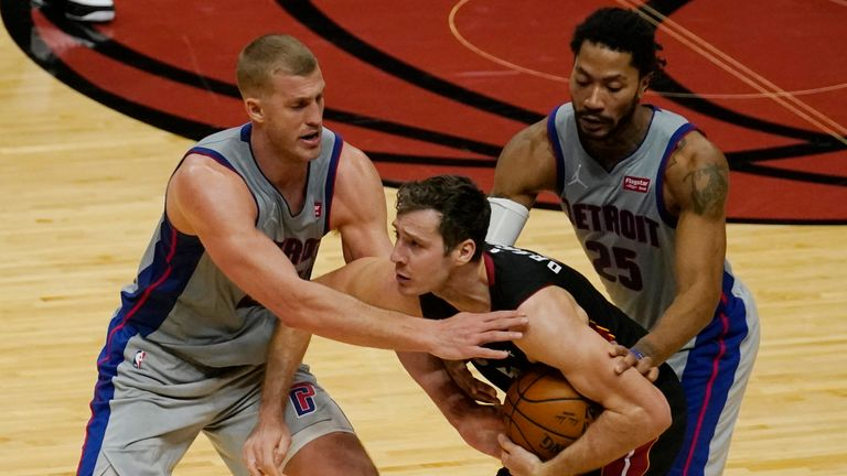 Detroit Pistons center Mason Plumlee and guard Derrick Rose (25) surround Miami Heat guard Goran Dragic (7) during the second half of an NBA basketball game, Monday, Jan. 18, 2021, in Miami. The Heat defeated the Pistons 113-107. (AP Photo/Marta Lavandier)