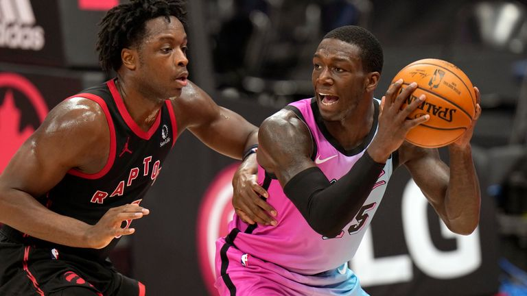 Miami Heat guard Kendrick Nunn (25) looks to pass around Toronto Raptors forward OG Anunoby (3) during the second half of an NBA basketball game Wednesday, Jan. 20, 2021, in Tampa, Fla.