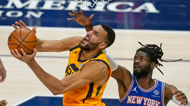 Utah Jazz center Rudy Gobert, left, lays the ball up as New York Knicks center Nerlens Noel (3) defends in the second half during an NBA basketball game Tuesday, Jan. 26, 2021, in Salt Lake City. (AP Photo/Rick Bowmer)