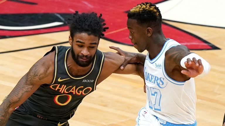 Chicago Bulls guard Coby White, left, drives against Los Angeles Lakers guard Dennis Schroeder during the first half of an NBA basketball game in Chicago, Saturday, Jan. 23, 2021.