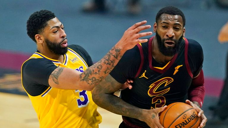 AP- Cleveland Cavaliers' Andre Drummond, right, drives past Los Angeles Lakers' Anthony Davis in the first half of an NBA basketball game