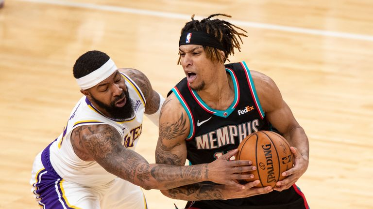 Los Angeles Lakers forward Markieff Morris (88) attempts to steal the ball from Memphis Grizzlies forward Brandon Clarke (15) during the second half of an NBA basketball game Sunday, Jan. 3, 2021, in Memphis, Tenn. (AP Photo/Wade Payne)