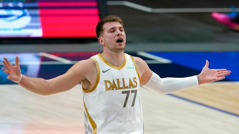 AP - Dallas Mavericks' Luka Doncic (77) gestures after missing on a 3-point shot attempt in the first half