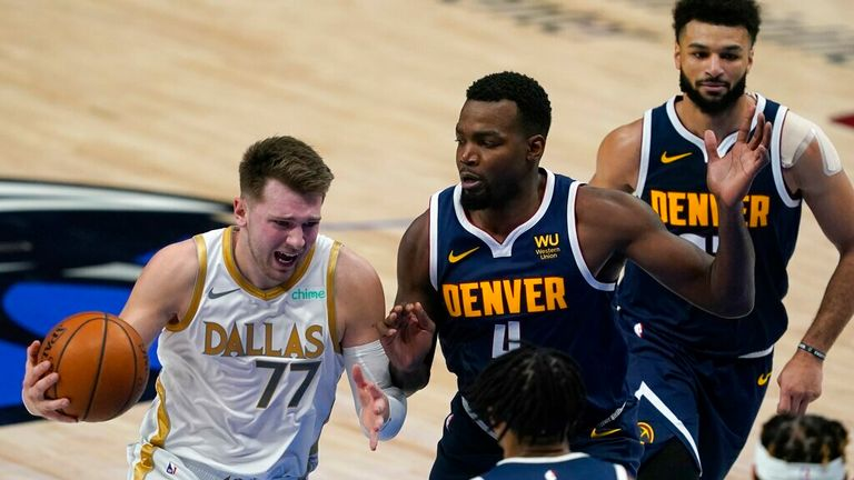 AP - Dallas Mavericks' Luka Doncic (77) moves to the basket against Denver Nuggets guard Gary Harris, bottom center, Paul Millsap (4) and Jamal Murray