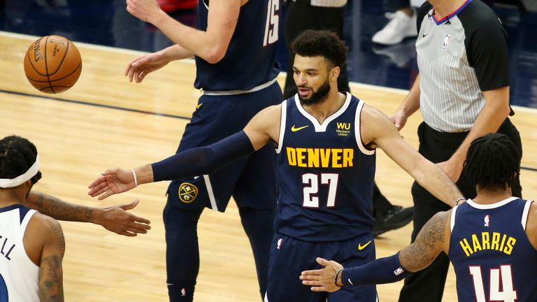 Denver Nuggets Jamal Murray is congratulated by teammates in the second quarter during an NBA basketball game against the Minnesota Timberwolves, Sunday, Jan. 3, 2021, in Minneapolis. (AP Photo/Andy Clayton-King)