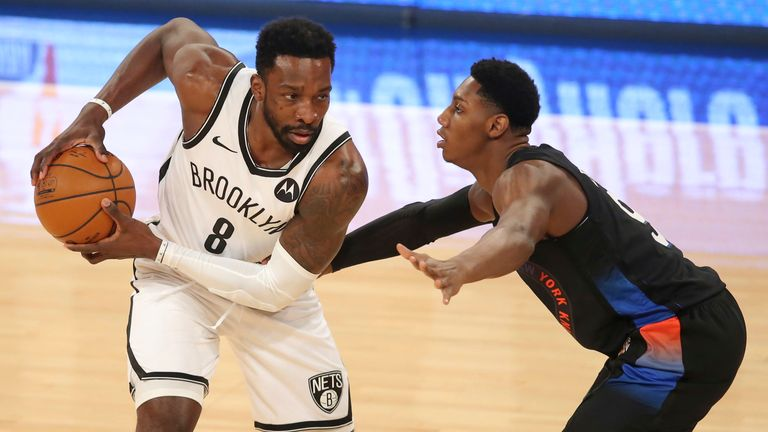 Brooklyn Nets forward Jeff Green (8) controls the ball against New York Knicks goalie RJ Barrett (9) in the first quarter of an NBA basketball game Wednesday, January 13, 2021, in New York City.  (Brad Penner / Pool photo via AP)
