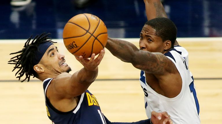 Denver Nuggets guard Gary Harris shoots against Minnesota Timberwolves center Ed Davis (17) in the fourth quarter during an NBA basketball game, Sunday, Jan. 3, 2021, in Minneapolis. (AP Photo/Andy Clayton-King)