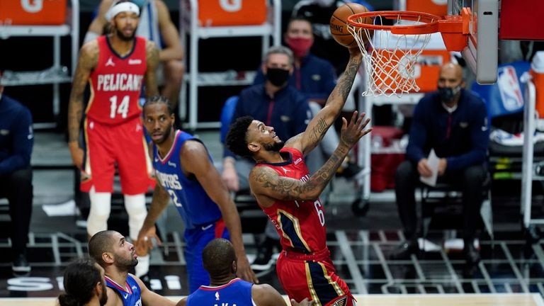 New Orleans Pelicans guard Nickeil Alexander-Walker (6) shoots past Los Angeles Clippers center Serge Ibaka (9) in the second quarter of an NBA basketball game on Wednesday, January 13, 2021 in Los Angeles.  (AP Photo / Ashley Landis)