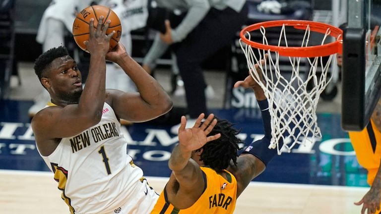 New Orleans Pelicans forward Zion Williamson (1) shoots as Utah Jazz center Derrick Favors (15) defends during the first half of an NBA basketball game Tuesday, Jan. 19, 2021, in Salt Lake City.