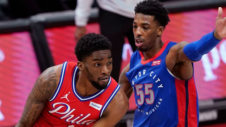 Philadelphia 76ers guard Shake Milton (18) looks to pass as Detroit Pistons guard Delon Wright (55) defends during the second half of an NBA basketball game, Saturday, Jan. 23, 2021, in Detroit.
