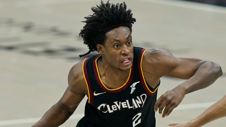 Cleveland Cavaliers' Collin Sexton, left, drives past Brooklyn Nets' Bruce Brown during the first half of an NBA basketball game, Wednesday, Jan. 20, 2021, in Cleveland.