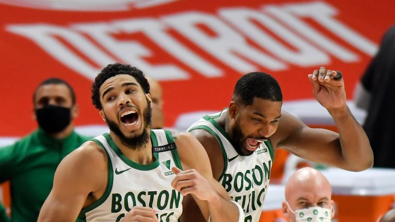 Boston Celtics' Jayson Tatum, left, and Tristan Thompson celebrate after a 122-120 win against the Detroit Pistons in an NBA basketball game, Sunday, Jan. 3, 2021, in Detroit. (AP Photo/Jose Juarez)
