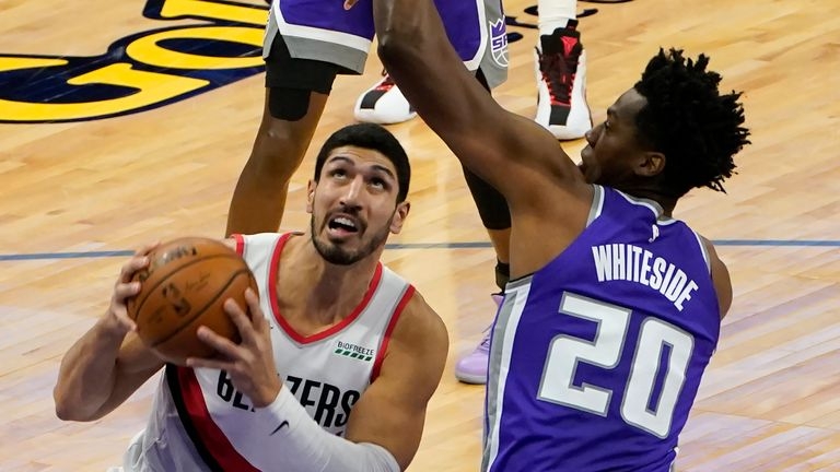 Portland Trail Blazers center Enes Kanter., Left, appears to be heading for Sacramento Kings center Hassan Whiteside in the second quarter of an NBA basketball game in Sacramento, California, on Wednesday, January 13, 2021.
