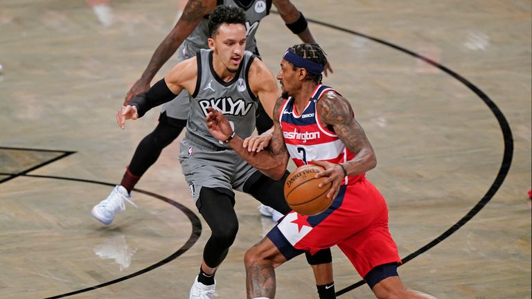 Washington Wizards guard Bradley Beal (3) drives around Brooklyn Nets guard Landry Shamet (13) during the third quarter of an NBA basketball game, Sunday, Jan. 3, 2021, in New York. (AP Photo/Kathy Willens)