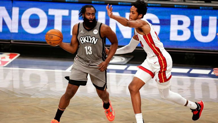 AP - Brooklyn Nets guard James Harden (13) looks to pass during the second half of an NBA basketball game against the Miami Heat,