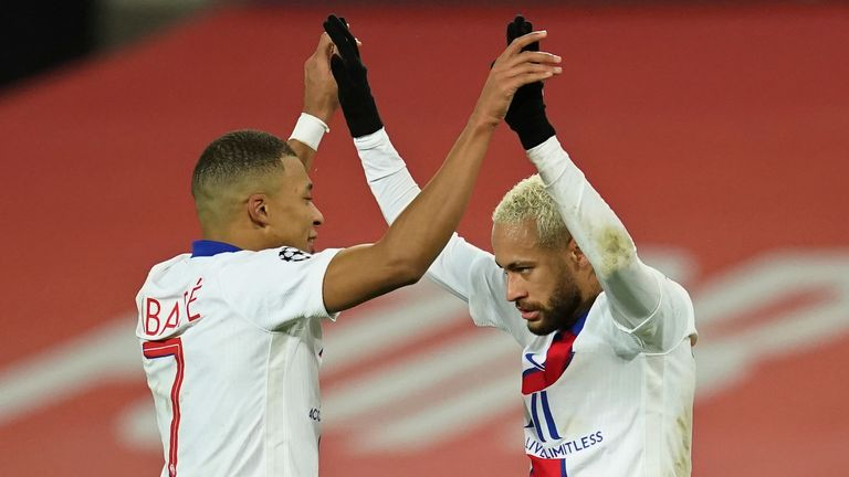 PSG's Neymar, right, celebrates with Kylian Mbappe after scoring his side's third goal during a Group H Champions League soccer match between Manchester United and Paris Saint Germain at the Old Trafford stadium in Manchester, England, Wednesday, Dec. 2, 2020. (AP Photo/Dave Thompson)