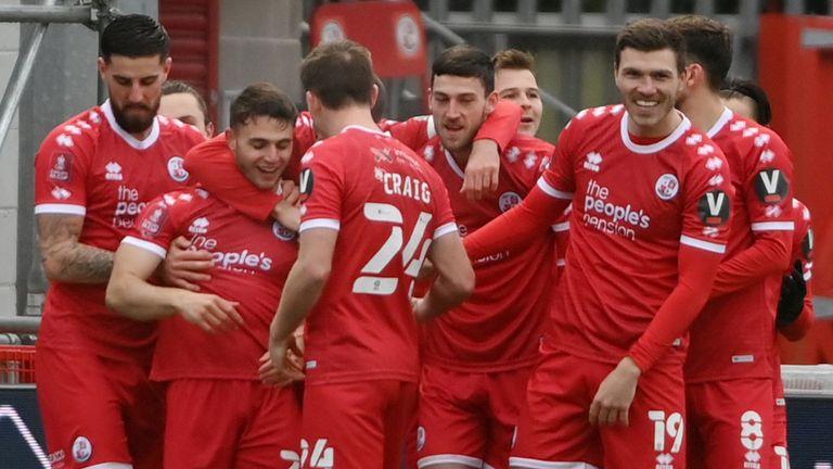 Crawley's Nicholas Tsaroulla celebrates with Jordan Tunnicliffe and team-mates vs Leeds in the FA Cup