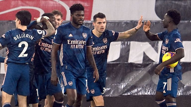 Nicolas Pepe celebrates his equaliser with Arsenal team-mates