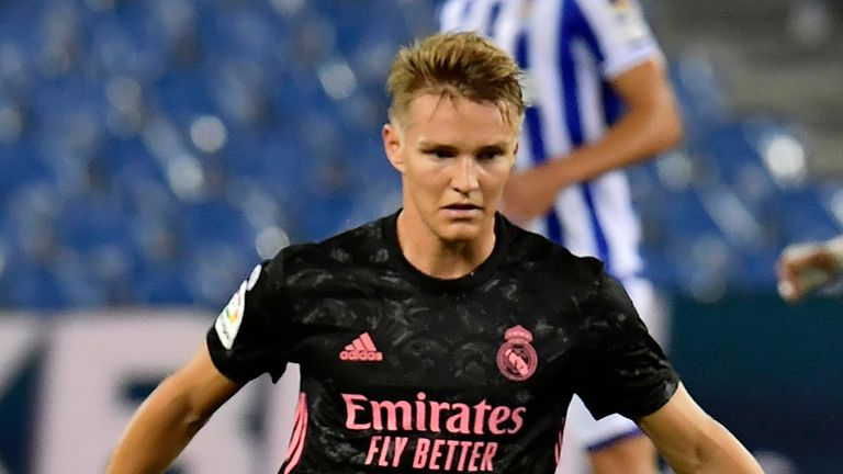 Real Madrid's Martin Odegaard fights for the ball against Real Sociedad's Aritz Elustondo during the Spanish La Liga soccer match between Real Sociedad and Real Madrid at the Anoeta stadium in San Sebastián, Spain, Sunday, Sept. 20, 2020.