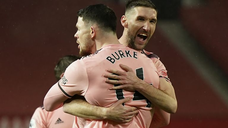 Oliver Burke celebrates with Chris Basham after scoring the winner