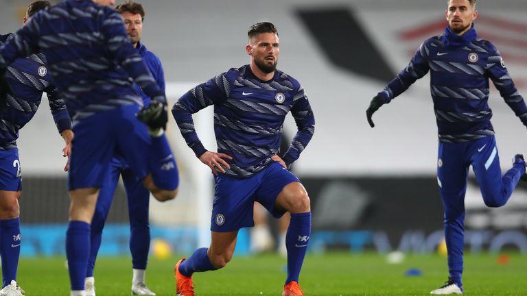 Olivier Giroud warms up ahead of Fulham vs Chelsea